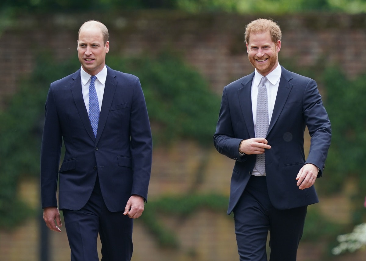 Prince William, Duke of Cambridge (left) and Prince Harry, Duke of Sussex arrive for the unveiling o...
