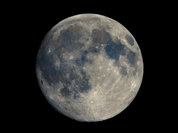 Full moon seen with an astronomical telescope, high resolution composite stacked colour image, impro...