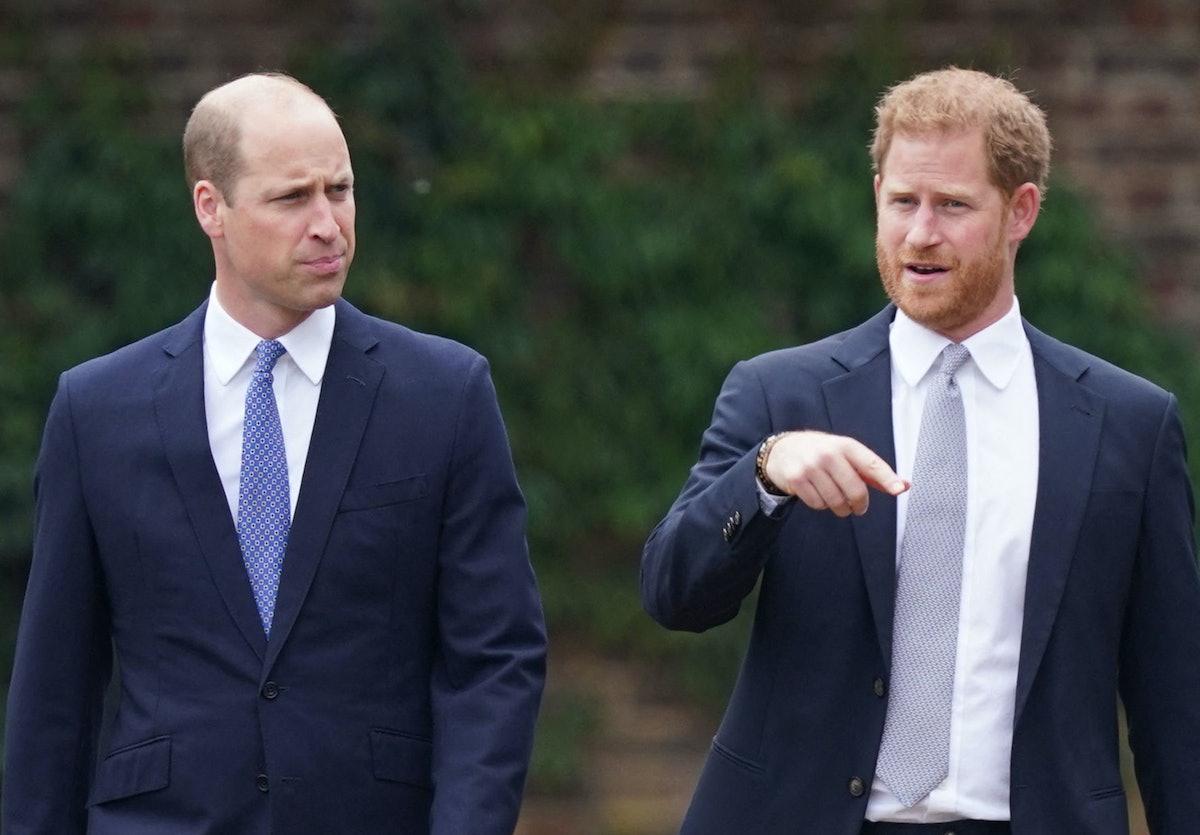 Britain's Prince William, Duke of Cambridge (L) and Britain's Prince Harry, Duke of Sussex chat ahea...