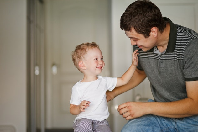 little boy and dad laughing