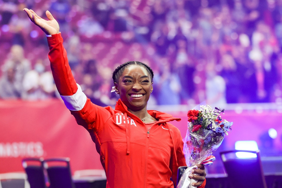 Simone Biles, who will compete at the 2021 Olympics, waves to the crowd as she exits following the Women's competition of the 2021 U.S. Gymnastics Olympic Trials.