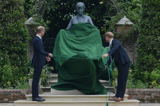Prince William, Duke of Cambridge (L) and Prince Harry, Duke of Sussex unveil a statue of their moth...