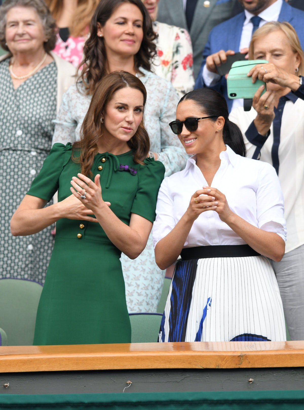 Catherine, Duchess of Cambridge and Meghan, Duchess of Sussex in the Royal Box on Centre Court durin...