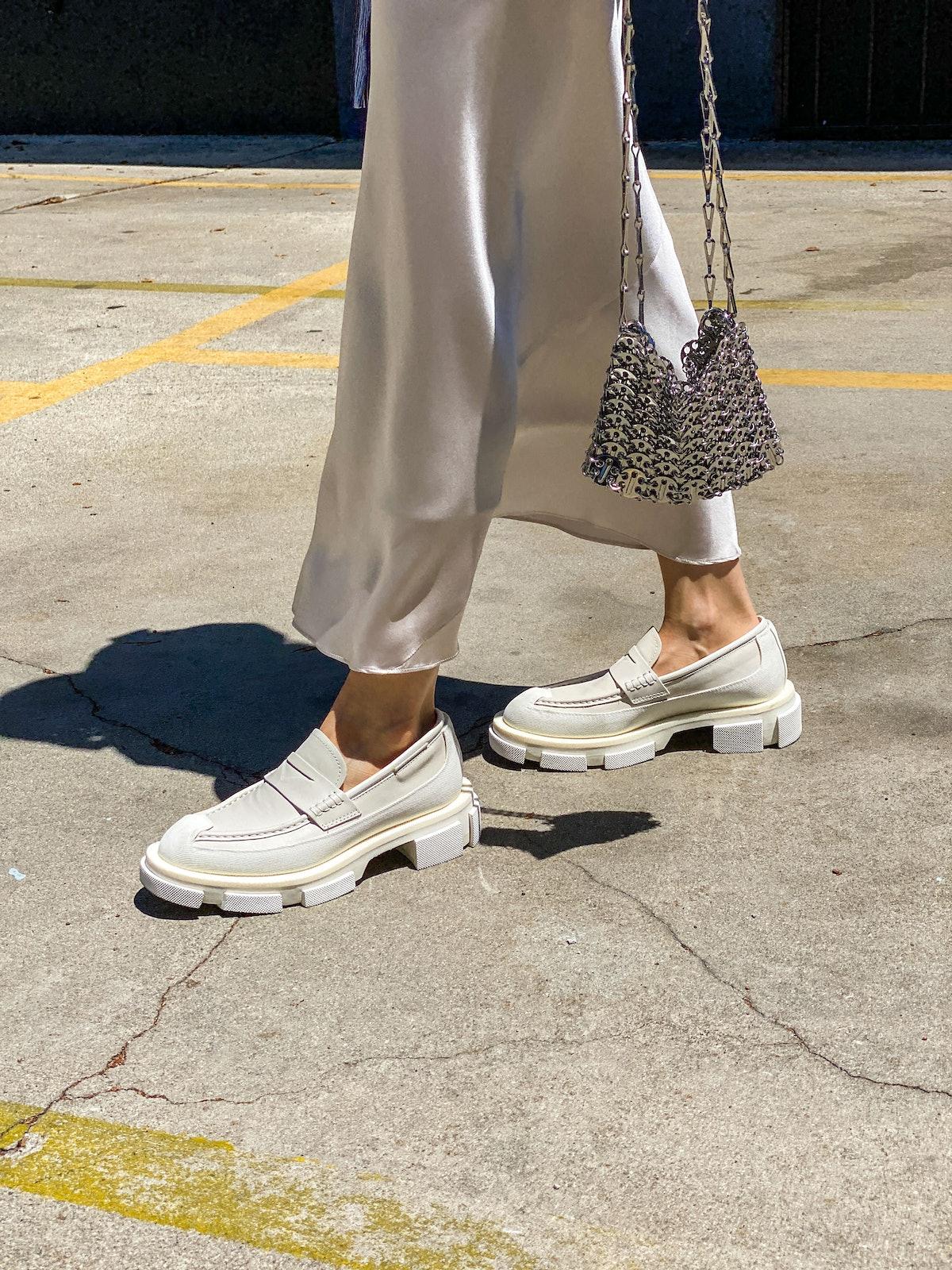 PARIS, FRANCE - JUNE 11: Julia Comil wears a silk satin skirt neutral off white by Dorothee Schumach...