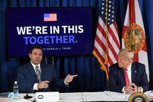 US President Donald Trump (R) and Florida's governor Ron DeSantis hold a COVID-19 and storm prepared...