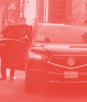 Passenger gets out of a Lyft/Uber car on Mission St. at the Embarcadero on Wednesday, Jan. 29, 2020,...