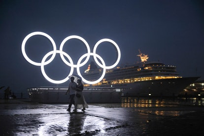 The Tokyo Olympics logo lit up at night. Can athletes drink during the Summer Olympics? the rules ar...