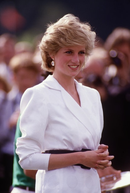 Princess Diana wears a feathered bob while watching polo in the '80s.