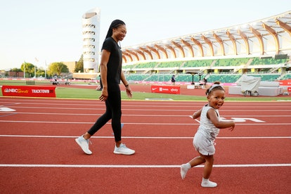 Allyson Felix celebrates with her daughter Camryn after day nine of the 2020 U.S. Olympic Track & Fi...