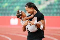 EUGENE, OREGON - JUNE 26: Allyson Felix celebrates with her daughter Camryn after day nine of the 20...