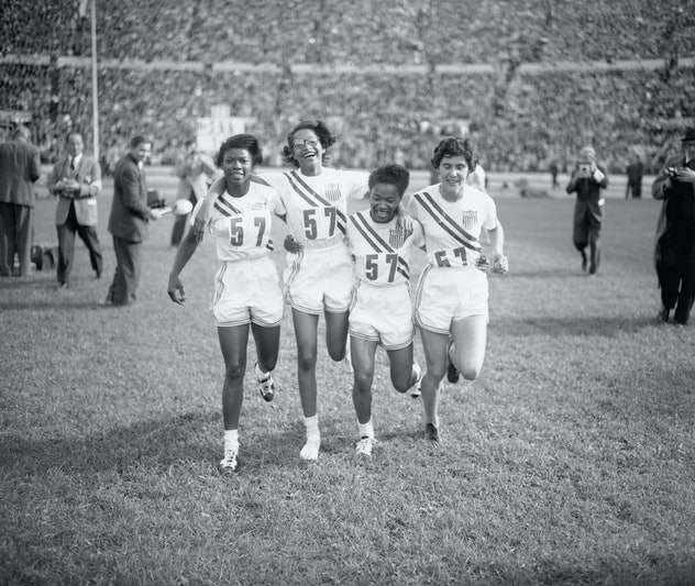 The US women's 4×100 metres relay team, winners of the event, at the Olympic Stadium during the Summ...