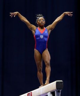 ST LOUIS, MISSOURI - JUNE 25:  Simone Biles warms up on the balance beam prior to the Women's compet...