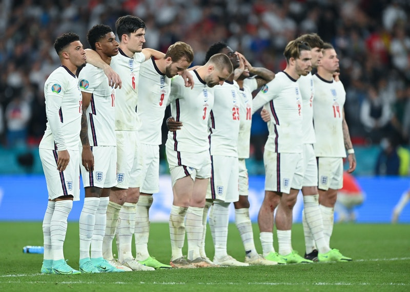 LONDON, ENGLAND - JULY 11: Jadon Sancho of England reacts with teammates after his penalty miss duri...