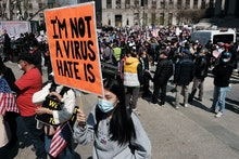 NEW YORK, NEW YORK - APRIL 04: People participate in a protest to demand an end to anti-Asian violen...