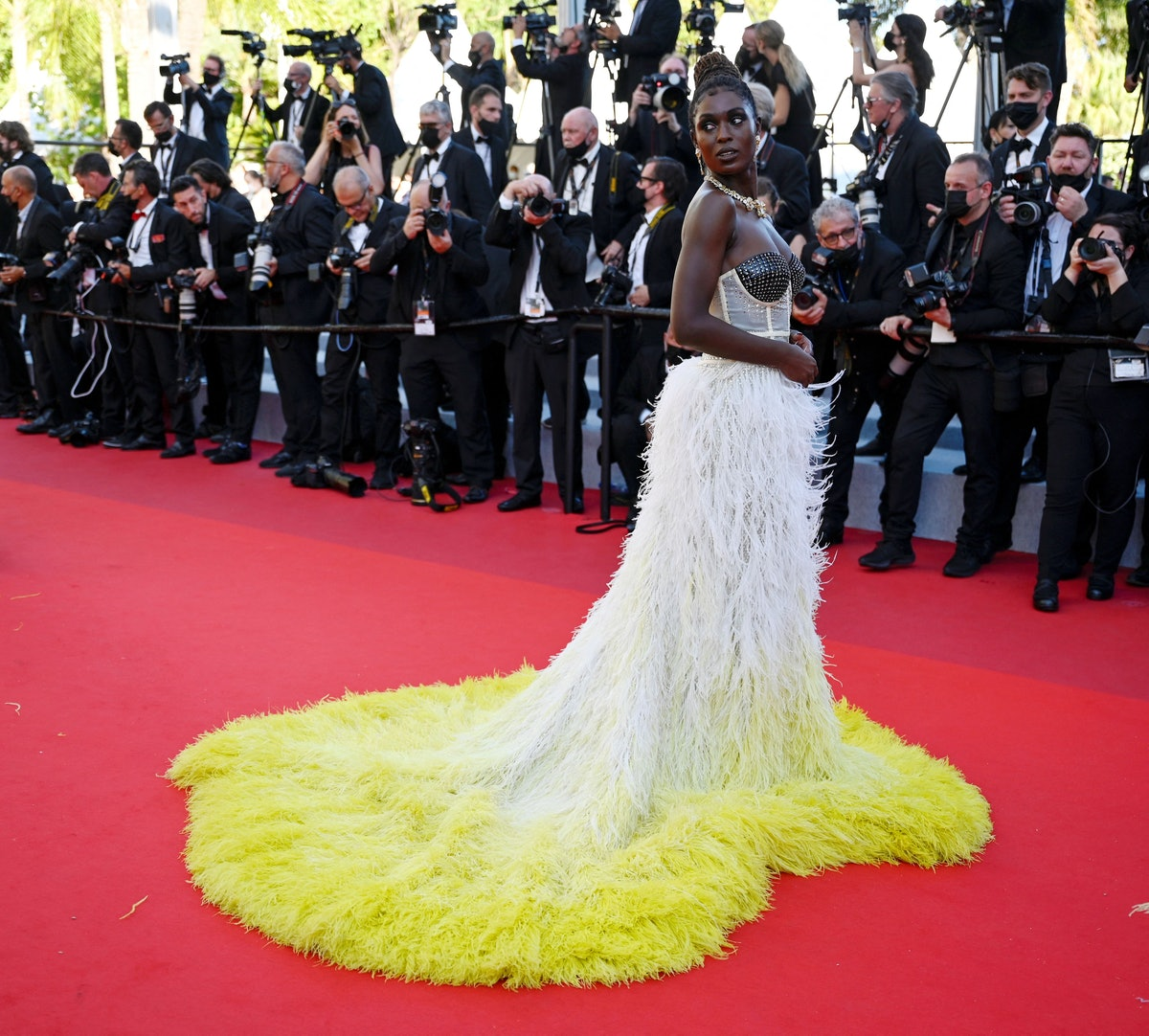 The show-stopping looks on the Cannes red carpet are some of the best of 2021 so far. From Bella Hadid's Schiaparelli necklace as a bra top to Jodie Turner-Smith's flowing Gucci train, here are the most memorable outfits.
