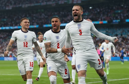 LONDON, ENGLAND - JULY 11: Luke Shaw of England celebrates with teammate Kyle Walker after scoring their team's first goal during the UEFA Euro 2020 Championship Final between Italy and England at Wembley Stadium on July 11, 2021 in London, England. (Photo by Eddie Keogh - The FA/The FA via Getty Images)