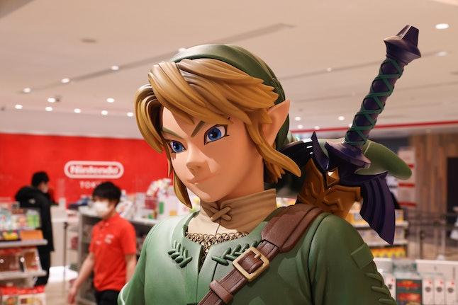 TOKYO, JAPAN - 2021/03/03: Link figurine from Legend of Zelda with shop staff inside Nintendo Tokyo ...