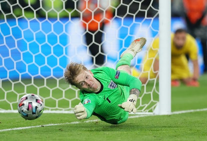 LONDON, ENGLAND - JULY 11: Jordan Pickford of England saves Italy's fifth penalty from Jorginho of Italy (not pictured) during the penalty shoot out during the UEFA Euro 2020 Championship Final between Italy and England at Wembley Stadium on July 11, 2021 in London, England. (Photo by Eddie Keogh - The FA/The FA via Getty Images)