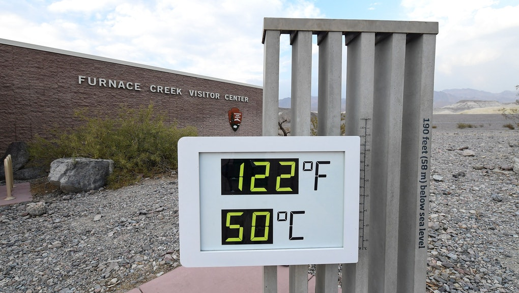 The temperature gauge at the Furnace Creek Visitors Center in Death Valley displays 125 degrees afte...