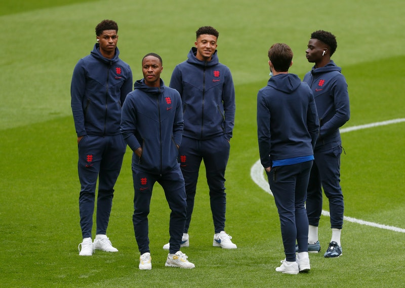 Marcus Rashford, Raheem Sterling, Jadon Sancho, Ben Chilwell, and Bukayo Saka of England on the football pitch