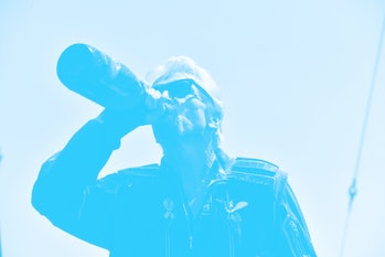 Virgin Galactic founder Sir Richard Branson, drinks champagne with crew members after flying into sp...
