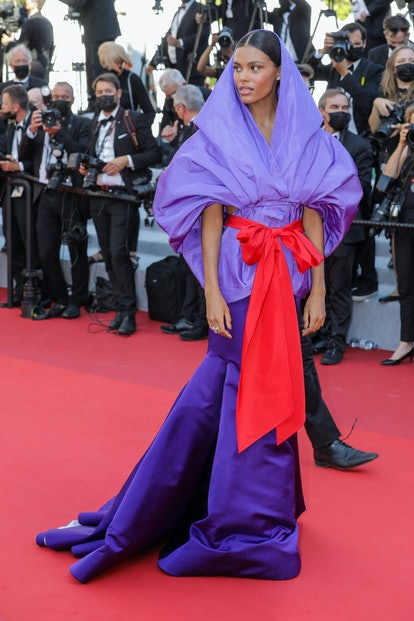 """CANNES, FRANCE - JULY 09: Tina Kunakey Cassel attends the """"Benedetta"""" screening during the 74th annu..."""