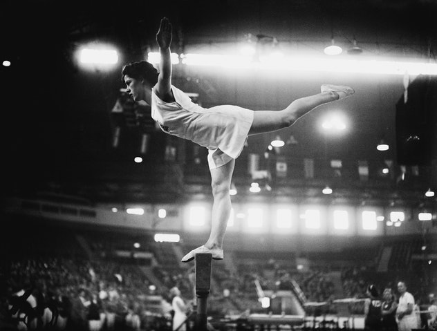Cissie Davies of Great Britain on the balance beam at Empress Hall, Earl's Court, during the gymnast...