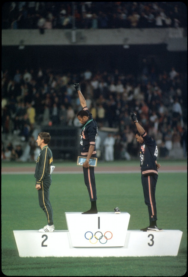12-27 OCT 1968:  Tommy Smith (307) (1st place) and John Carlos (259) (3rd place) of the US raise the...