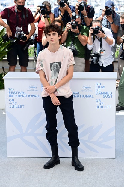 """CANNES, FRANCE - JULY 13: Timothée Chalamet attends the """"The French Dispatch"""" photocall during the 7..."""