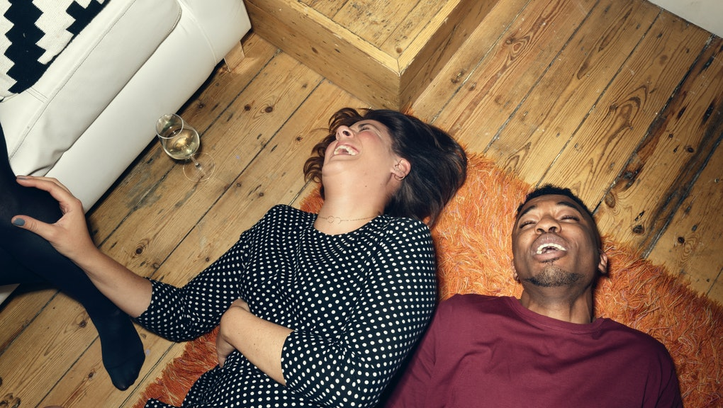 young people at a party, lying on the floor, having a good time