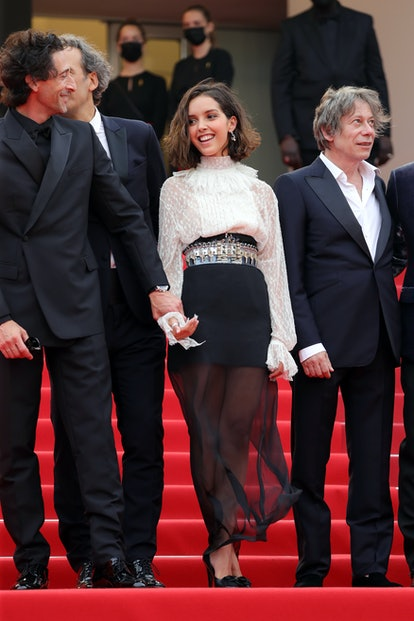 CANNES, FRANCE - JULY 12: Adrien Brody, Alexandre Desplat, Lyna Khoudri and Mathieu Amalric attend t...