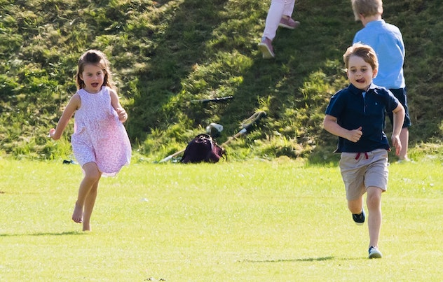 Prince George runs in shorts.