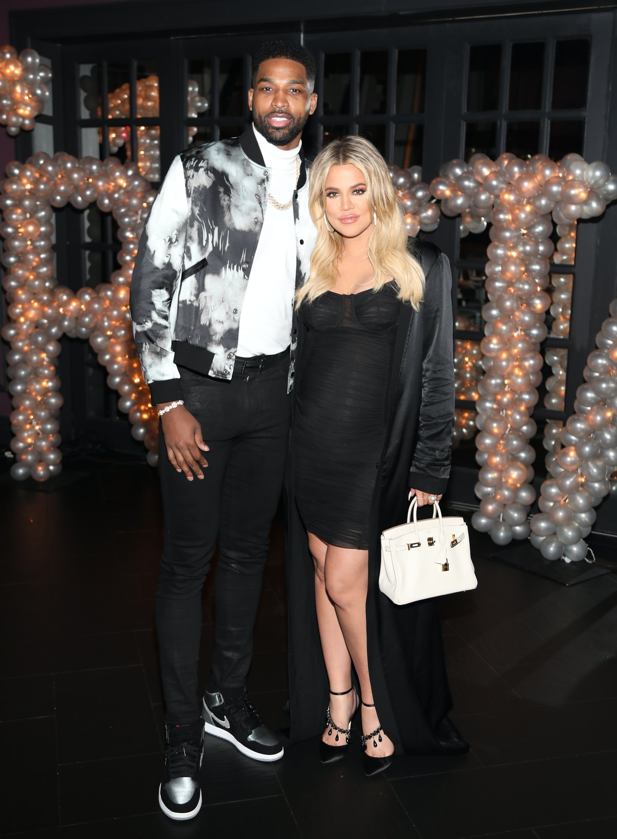 LOS ANGELES, CA - MARCH 10:  Tristan Thompson and Khloe Kardashian pose for a photo as Remy Martin c...