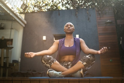 Woman meditating in the backyard with breathwork exercises