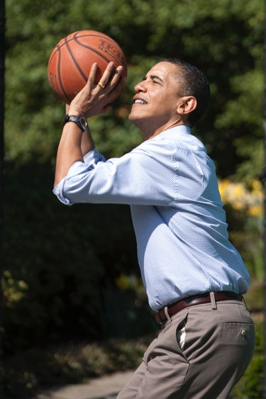 U.S. President Barack Obama shoots for the hoop as he plays basketball with children during the 2010 Easter Egg Roll on the South Lawn of the White House in Washington. (Photo by Brooks Kraft LLC/Corbis via Getty Images)