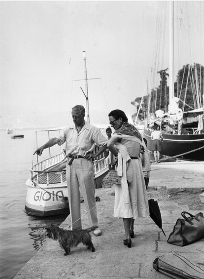 The Duke (1894 - 1972) and Duchess (1896 - 1986) of Windsor on the quayside at Portofino with their dog.