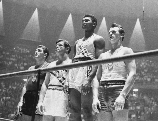 The winners of the 1960 Olympic medals for light heavyweight boxing on the winners' podium at Rome: ...