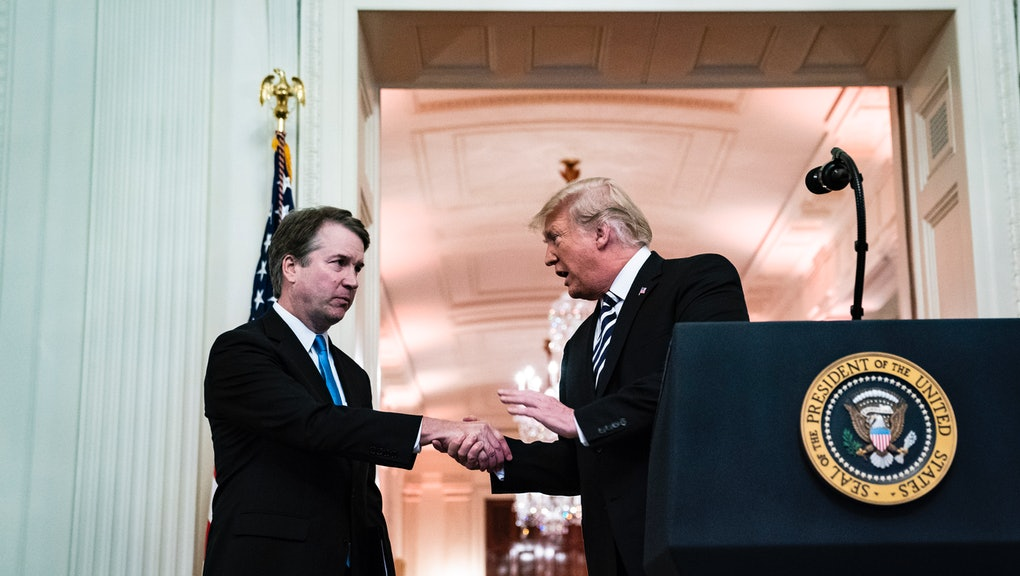 WASHINGTON, DC - OCTOBER 8 : Associate Justice Brett Kavanaugh greets President Donald J. Trump duri...