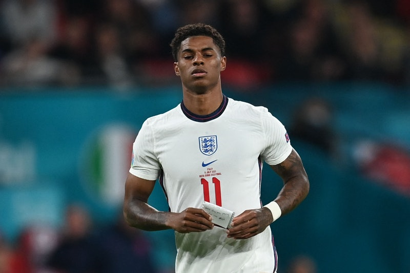 England's forward Marcus Rashford carries a note during the UEFA EURO 2020 final football match between Italy and England at the Wembley Stadium in London on July 11, 2021. (Photo by Paul ELLIS / POOL / AFP) (Photo by PAUL ELLIS/POOL/AFP via Getty Images)