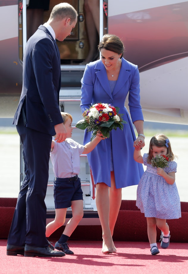 Prince George checks out his mom's flowers.