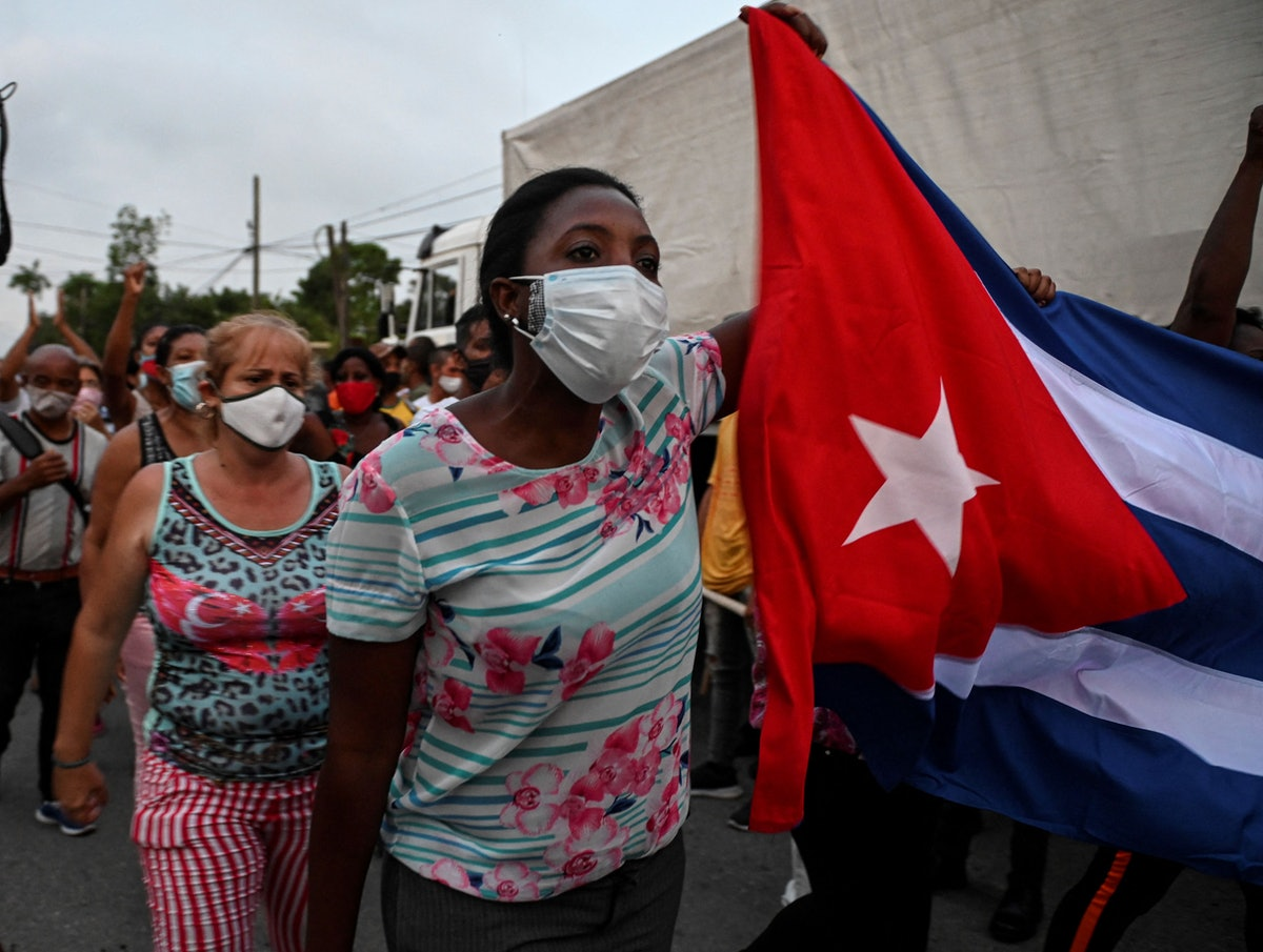 Cubans take part in a demonstration in support of Cuban President Miguel Diaz-Canel's government in ...
