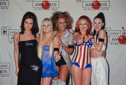 Victoria Beckham, Emma Bunton, Melanie Brown, Geri Halliwell, and Melanie Chisholm of the Spice Girls show off their '90s style on the red carpet.