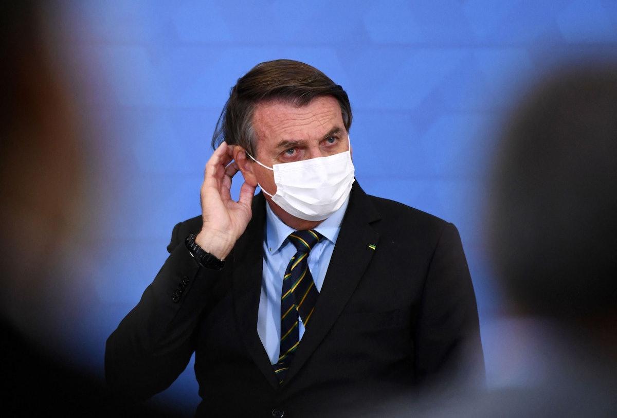 Brazilian President Jair Bolsonaro gestures as he speaks during the announcement of support measures...