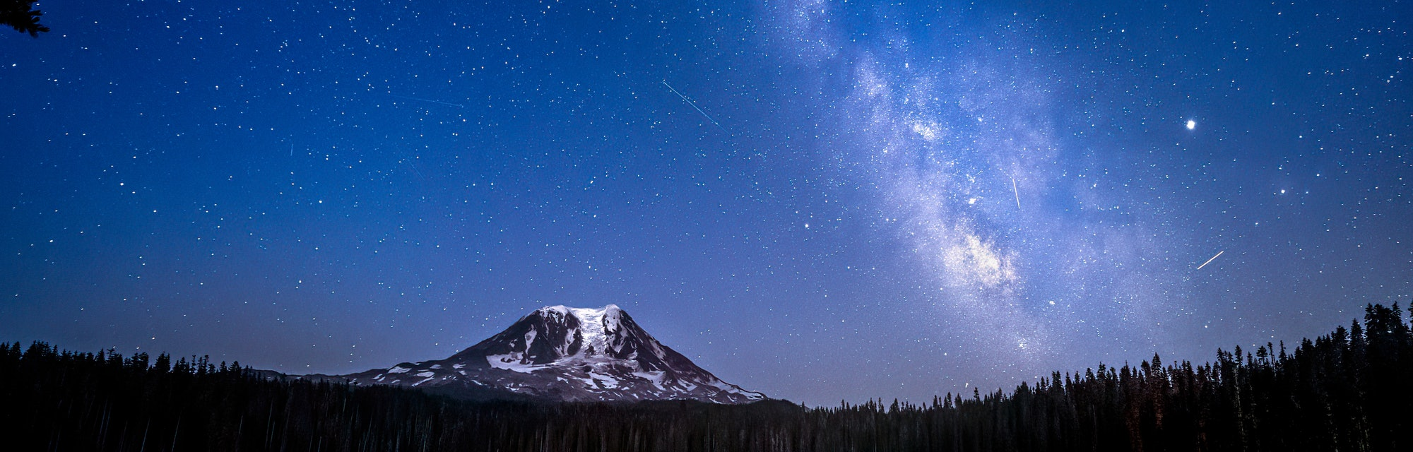 The Delta Aquariids meteor shower and Milky Way over Mt. Adams at Lake Takhlakh, Washington State