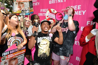 """Fans and supporters of Britney Spears gather outside the Los Angeles County Courthouse in Los Angeles, on July 14, 2021, during a scheduled hearing in the Britney Spears guardianship case. - Three weeks after Britney Spears sensationally called for an end to her """"abusive"""" guardianship, the pop singer's legal battle returns to court July 14 in Los Angeles. Spears gave explosive testimony on June 23 in which she pleaded with a California judge to allow her to end the conservatorship long controlled by her father, and to choose her own lawyer."""