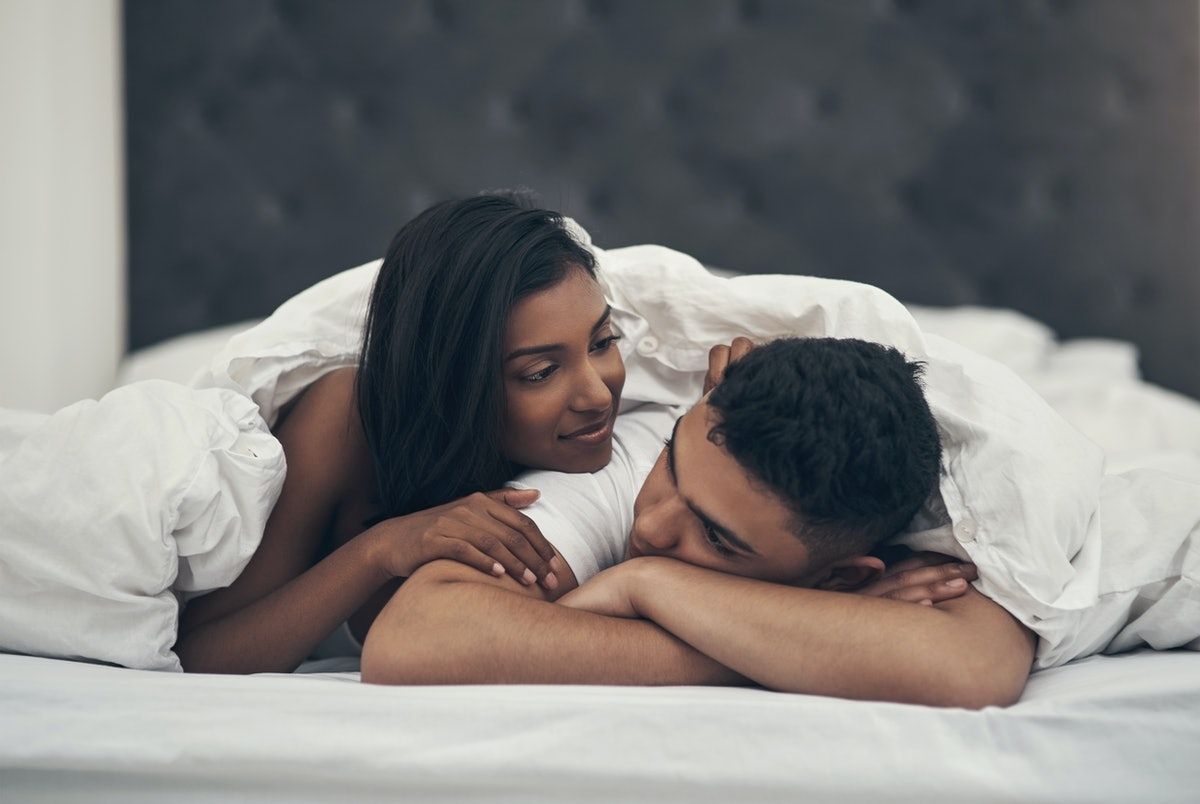 Man struggling to get an erection is comforted by girlfriend