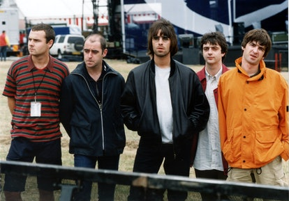 '90s rock group Oasis stand together before a show.