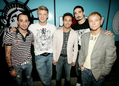 The Backstreet Boys attend a live recording of TRL to promote an album in the '90s.