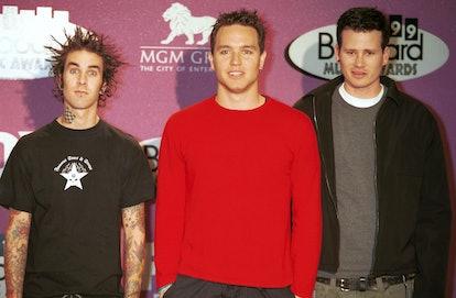 '90s pop punk band Blink 182 attend the Billboard awards.