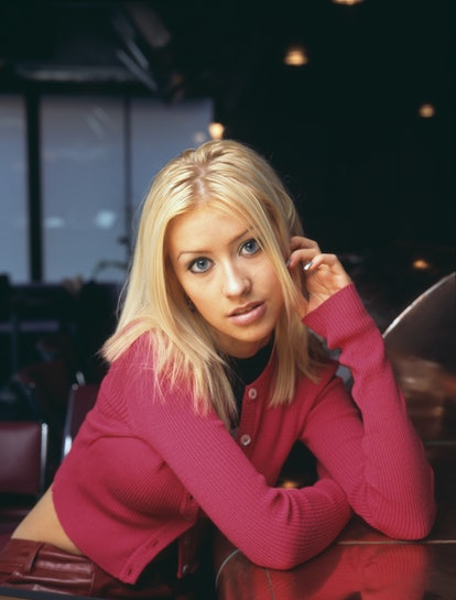 '90s pop star Christina Aguilera takes a photo at the start of her career.